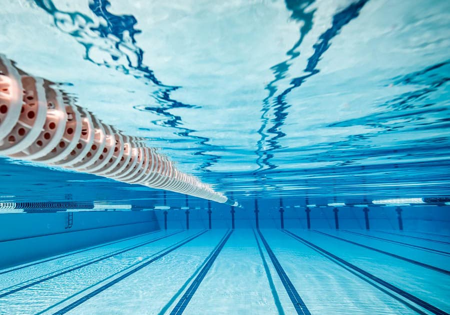 An underwater view of a swimming pool to represent pool and aquatics software for Pool Memberships, Online Registration, and Management